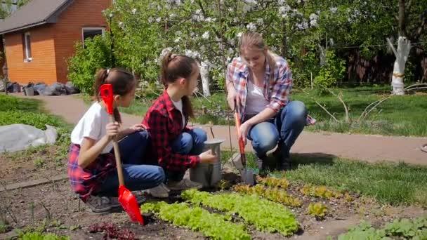 Slow motion video of happy family working in backyard garden