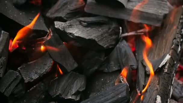 Slow motion video of hot red charcoal burning