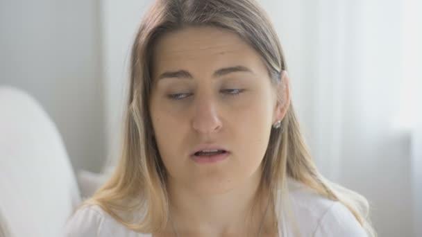 Closeup shot of sick woman sneezing in handkerchief