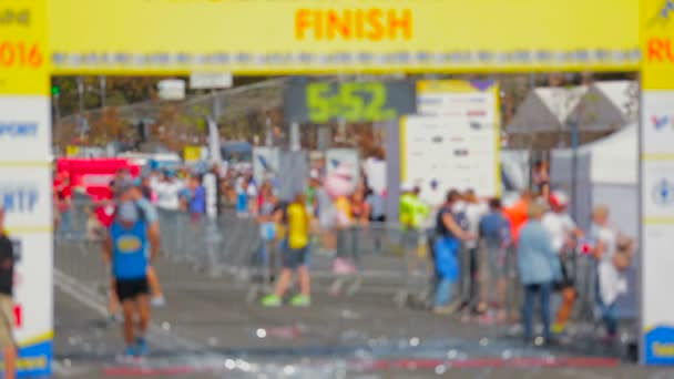 Out of focus shot of finish line at city marathon
