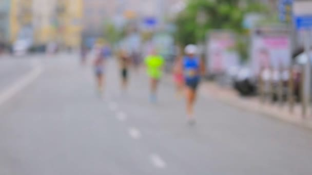Group of athletes running on city marathon on street