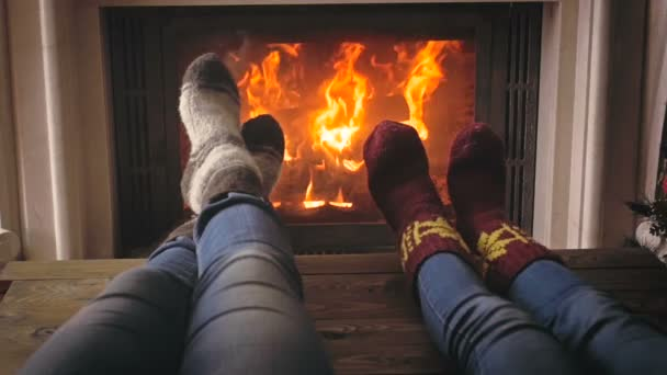 Closeup footage of couple in love relaxing by the fireplace at cold winter day