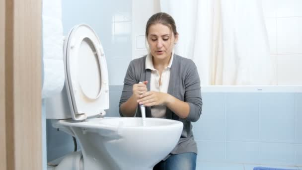 4k footage of exhausted upset housewife cleaning dirty toilet with brush