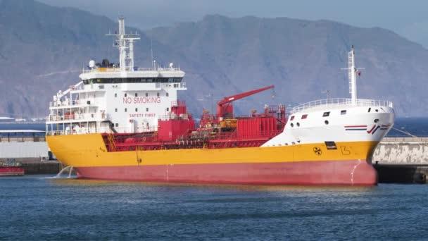 4k video of big cargo transport ship moored in port at harbour.