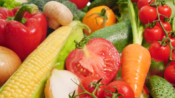 4k closeup dolly video of big heap of fresh and cut vegetables from farm. Concept of healthy nutrition and organic food. Perfect background for vegetarian or vegan