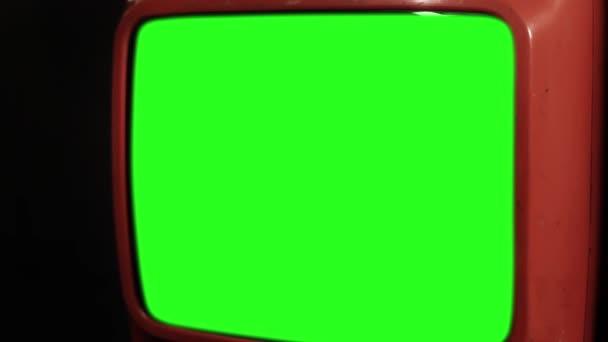 Vintage červené Tv s zeleným plátnem. Připravena nahradit zelenou obrazovku s záběry nebo obrázek, který chcete