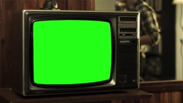 80-as években Greenscreen televízió. Tini Retro telefon beszélt. Kész arra, hogy cserélje ki a zöld képernyő felvétel vagy képet szeretne.