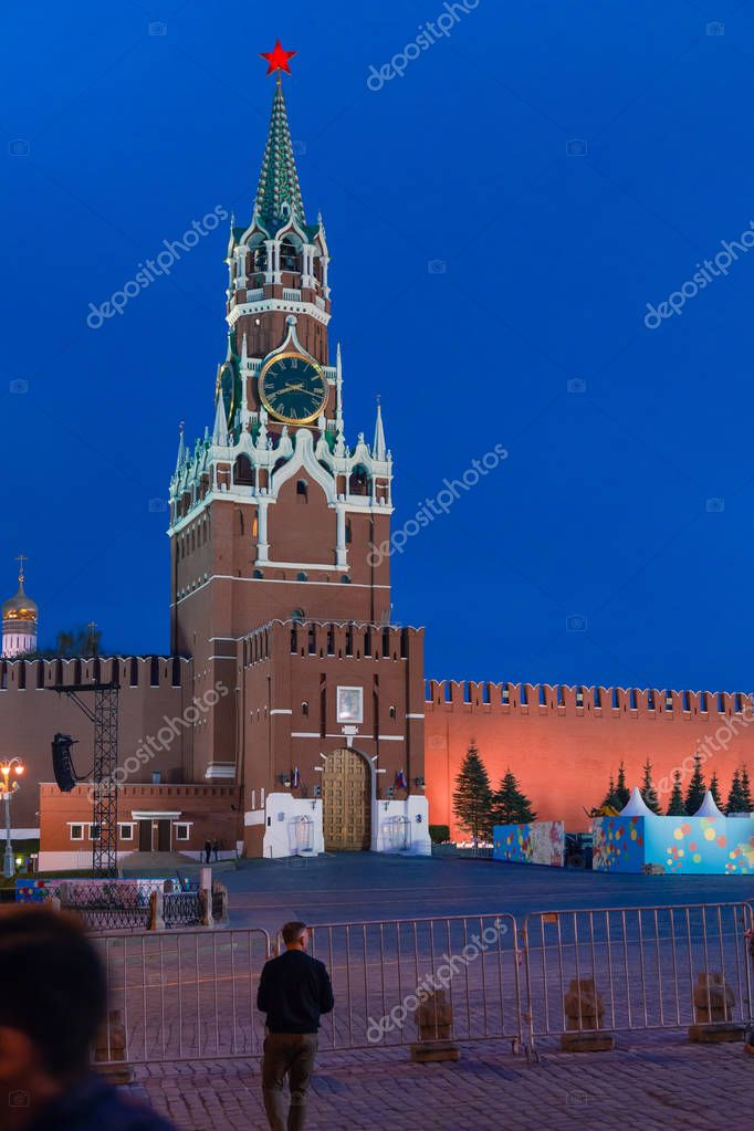 MOSCOW, RUSSIA - APRIL 30, 2018: View of the Spasskaya Tower of the Moscow Kremlin from Red Square on the eve of the May Day celebration.  Dusk before sunset
