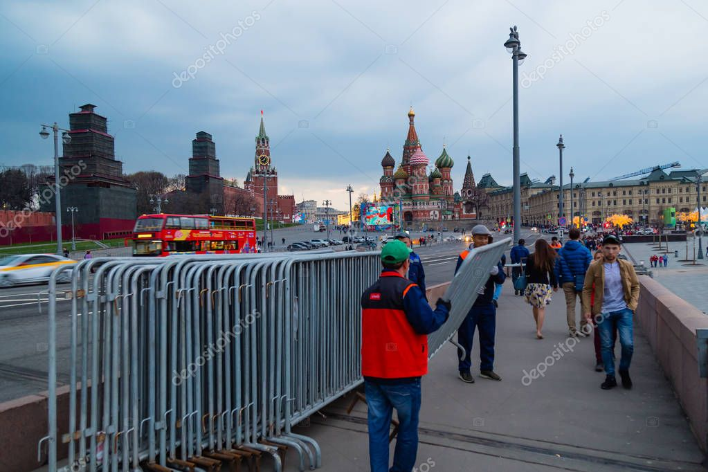 MOSCOW, RUSSIA - APRIL 30, 2018: View of the Red Square, St. Basil's Cathedral and the Spasskaya Tower of the Moscow Kremlin from the Bolshoy Moskvoretsky Bridge on the eve of the May Day celebration