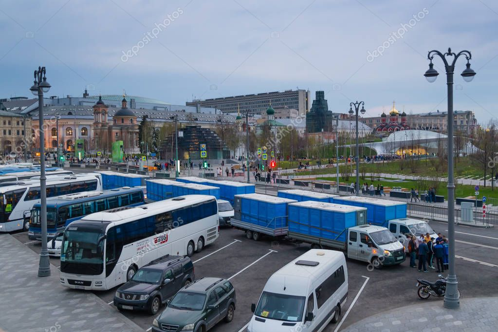 MOSCOW, RUSSIA - APRIL 30, 2018: Trucks with biotoilets near Red Square before the May 1 celebration. Top view from Bolshoy Moskvoretsky Bridge. Evening, before sunset.