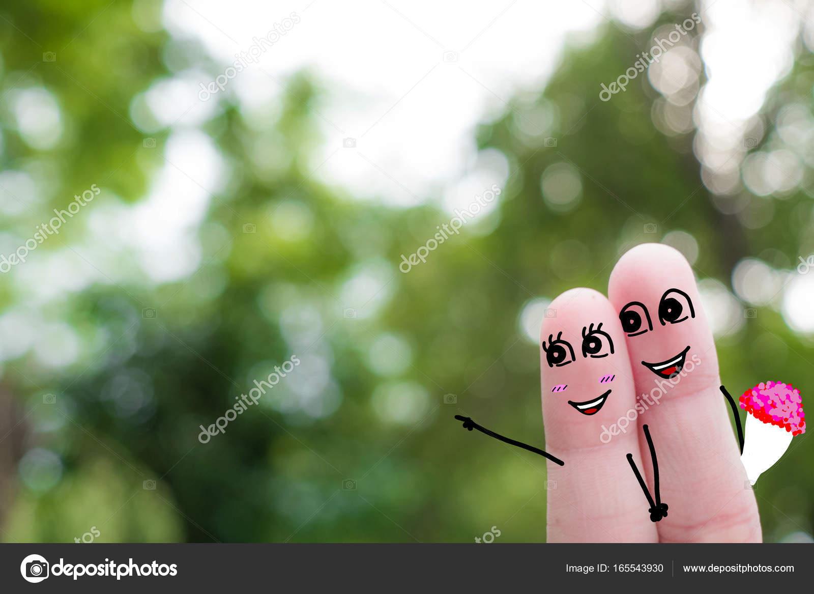 Arte del dedo de una pareja feliz. Abrazan a un hombre y una mujer ...