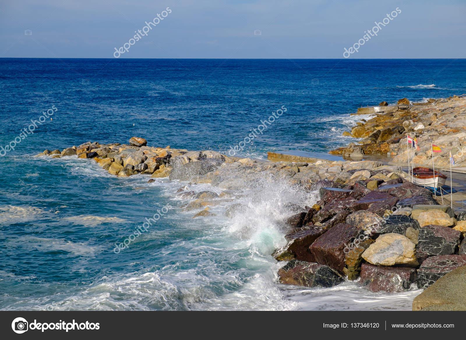 Deiva Marina Rocky Shore With Crystal Waves Liguria Italy Stock