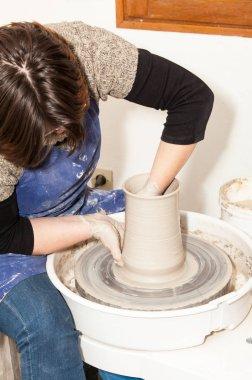 potter creating earthen jar