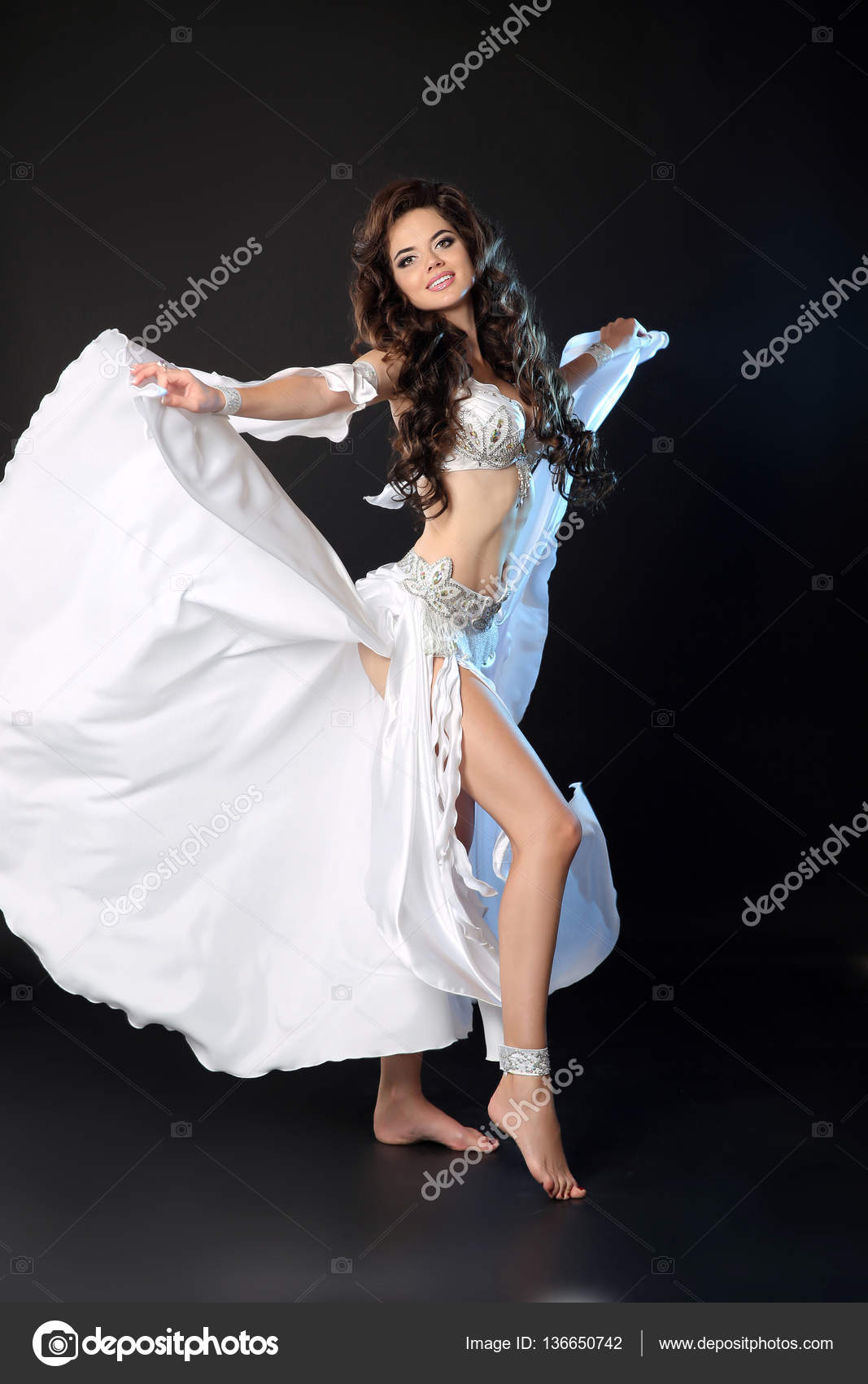 Bellydance Beautiful Arabic Sexy Belly Dancer In Blowing White Dress Dancing Isolated On Black Studio Background Attractive Smiling Turkish Female