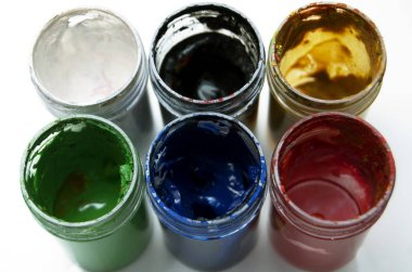 Used colorful paint buckets