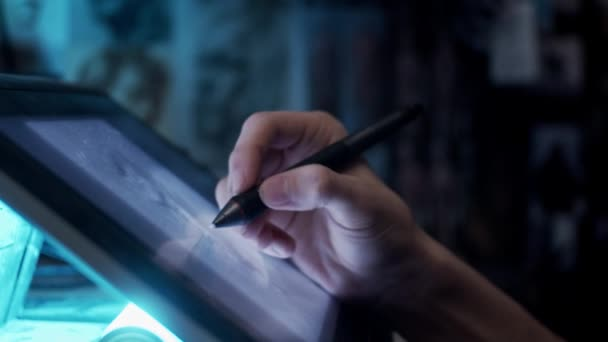 Young artist drawing illustration on tablet, slow motion, shallow depth of field