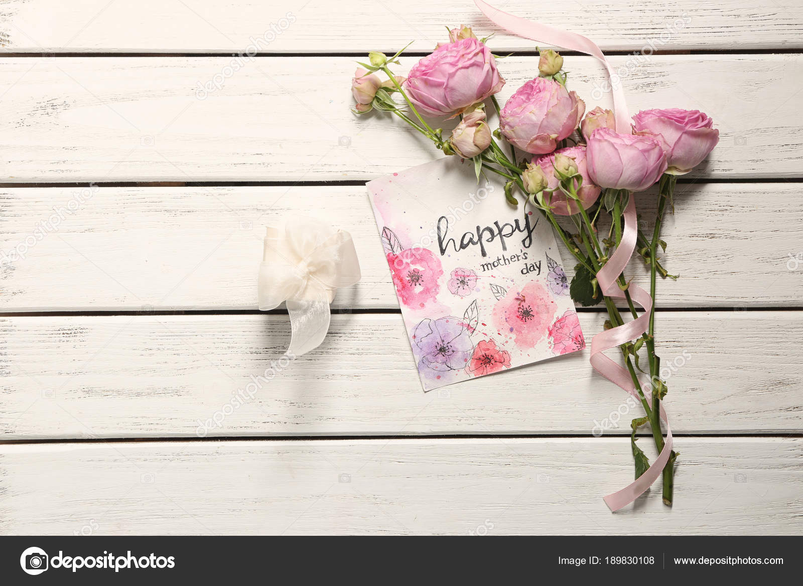 gift box flowers and card with words happy mother s day on wooden