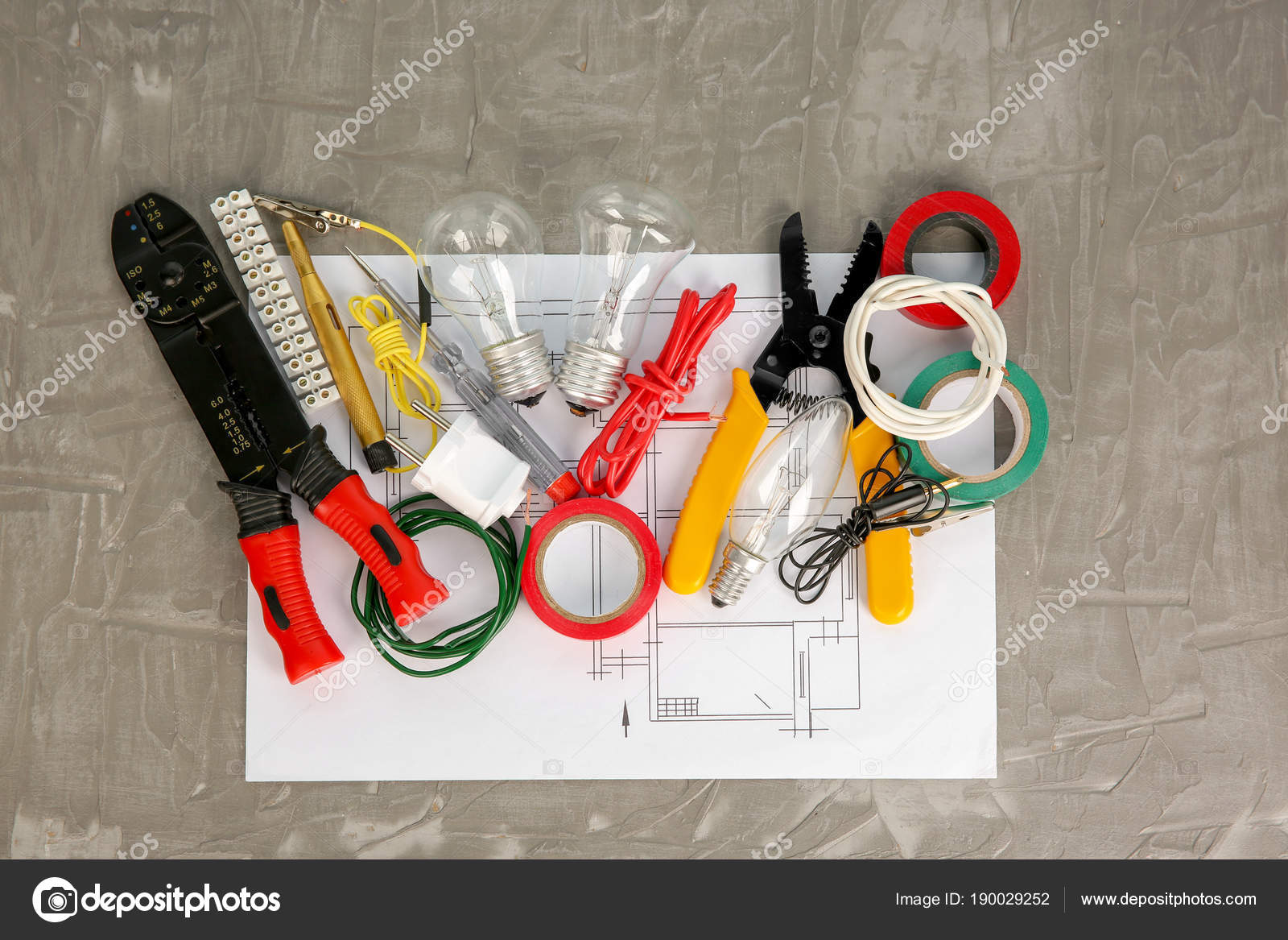 Flat lay composition with electrical tools and house plan on grey  background — Stock Photo