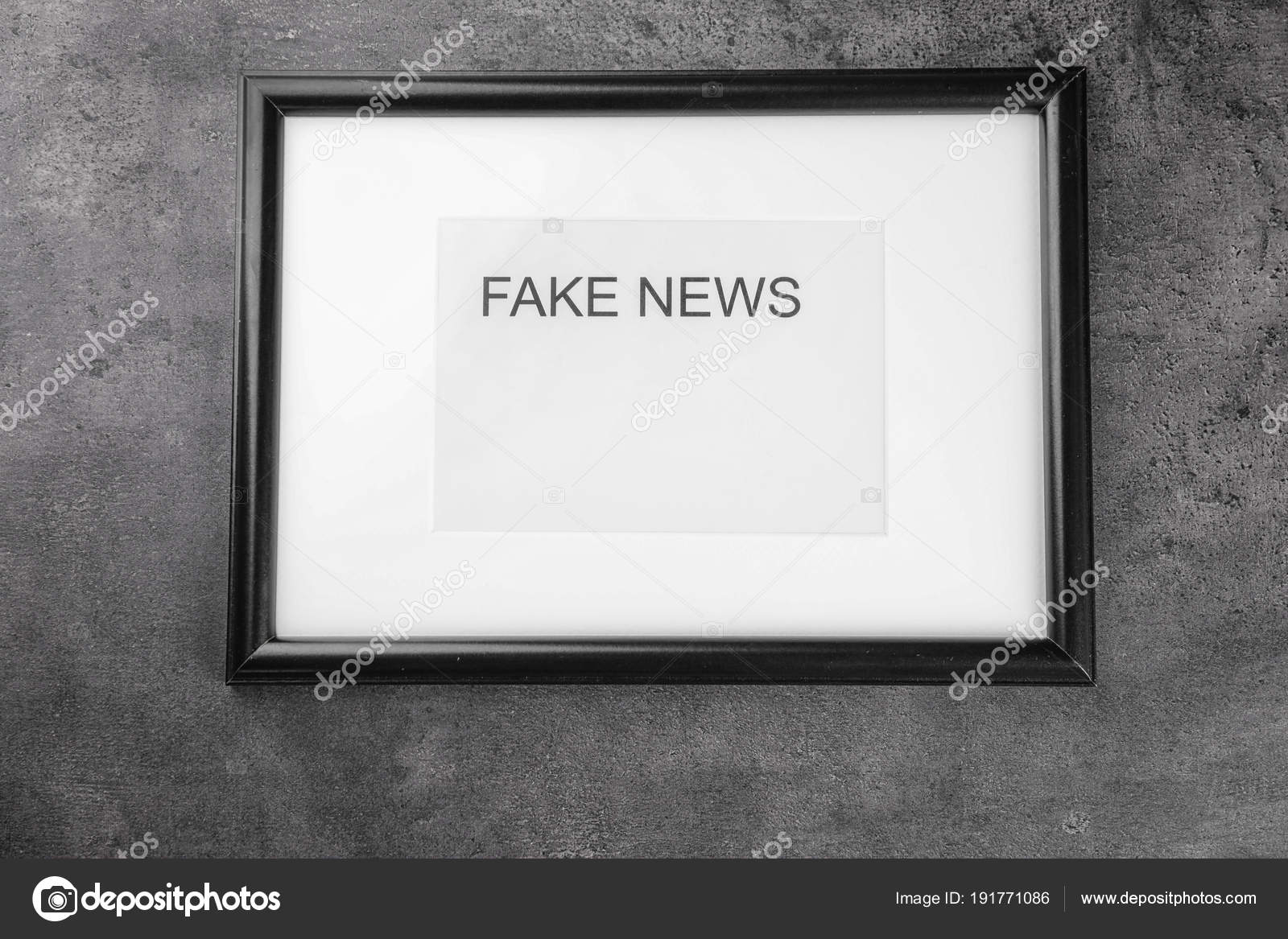 frame with words fake news on gray background stock photo