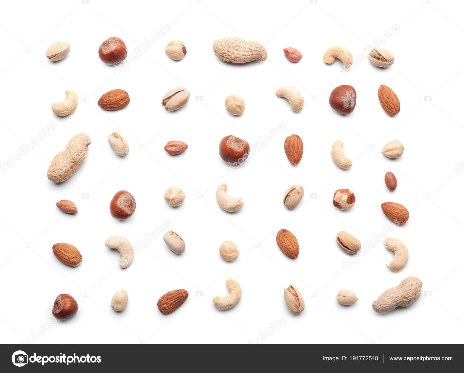 Different types of nuts on white background — Stock Photo