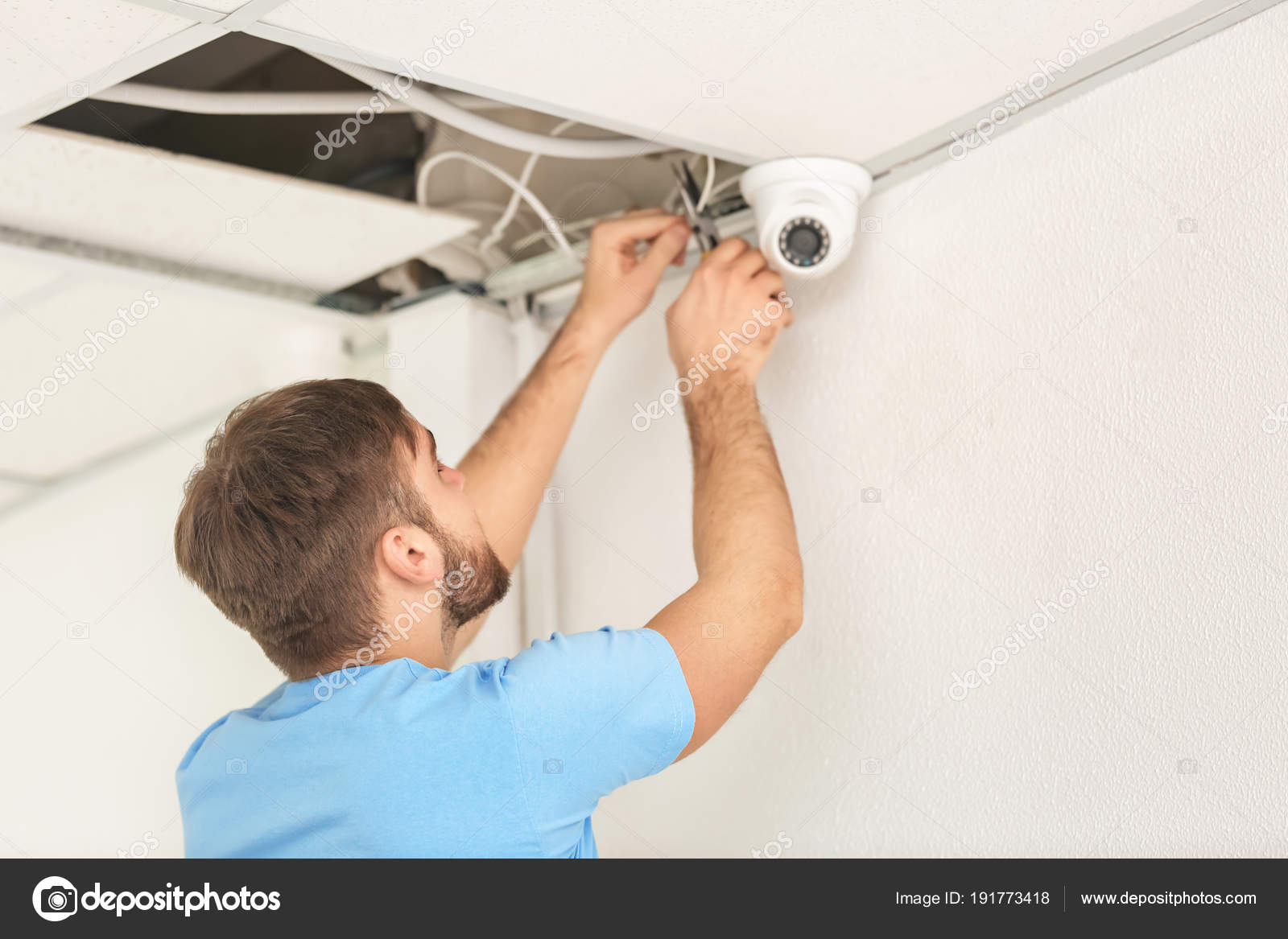 Electrician Installing Security Camera Indoors Stock Photo Wiring A House Homework