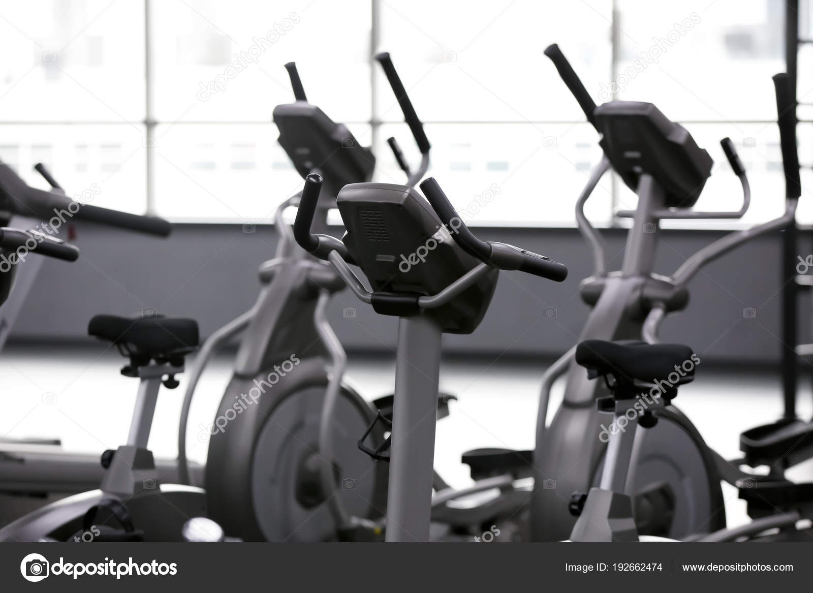 Modern exercise bicycles in gym — Stock Photo