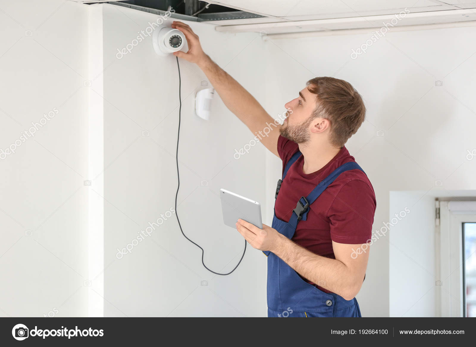 Electrician installing security camera indoors — Stock Photo ... on wiring a smoke detector, wiring a power supply, wiring a spy cameras, wiring a cable box, wiring a network, wiring a car, wiring a swimming pool, wiring a motion sensor,