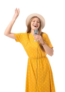 Beautiful young female singer with microphone on white background