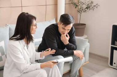 Psychologist working with patient in office