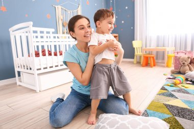 Nanny and cute little boy at home