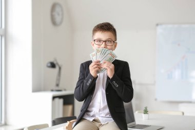 Little accountant with money in office