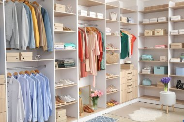 Modern wardrobe with stylish spring clothes and accessories