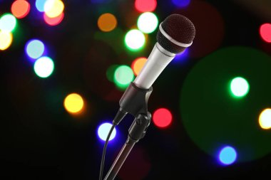 Microphone with stand on dark background