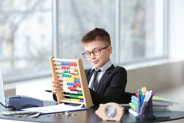 Little accountant working in office