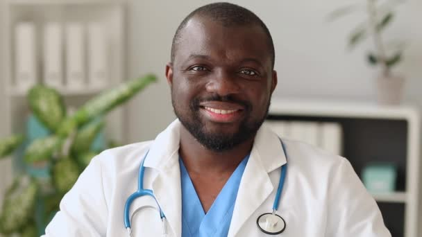 Handsome African-American doctor in modern clinic