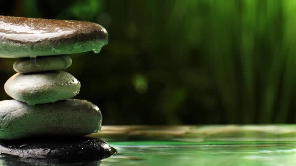 Stack of zen stones and water drops on blurred background