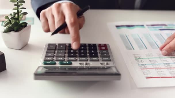 Bank manager crunching numbers at table, closeup