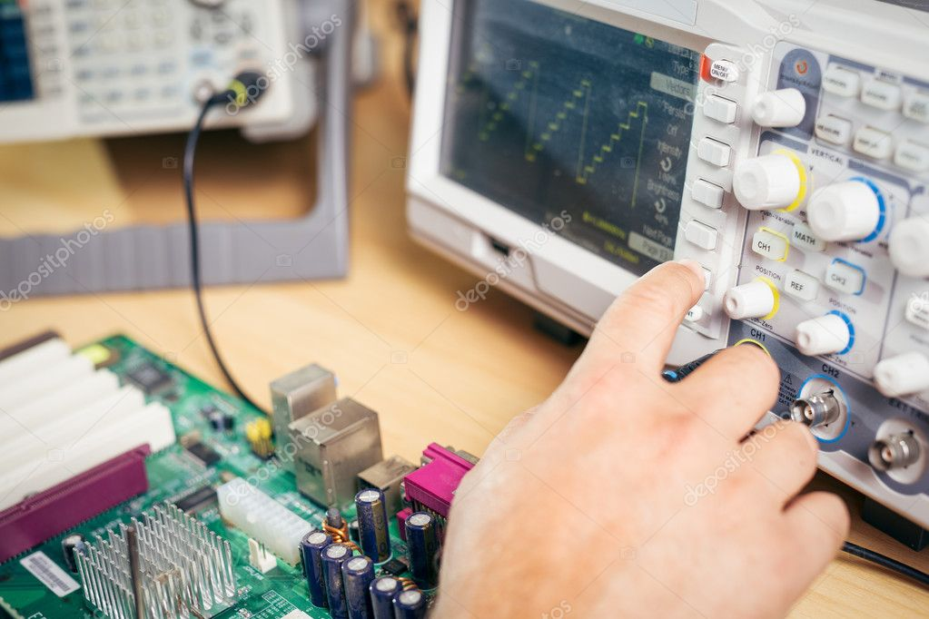 Engineer tests electronic components with oscilloscope in the