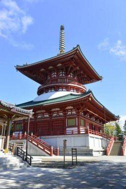 Narita, Japan - October 4, 2019: large red pagoda and blue sky in Naritasan Shinshoji temple. the most famous temple in Narita city at Chiba Prefecture