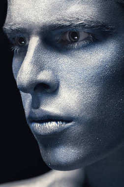 Portrait of man isolated at dark background. Art blue and grey Makeup. Skincare concept