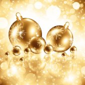 Sfondo con le bagattelle dorate di Natale