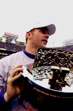 Quarterback Kerry Collins of the New York Giants holds up the MVP trophy he was won at the National League Championship game.The New York Giants went on to defeat the Minnesota Vikings by a final score of 41 to 0 on 01/14/01.