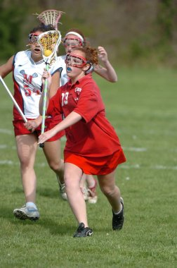 Girls High School Lacrosse game at action at a local school in Central New Jersey.