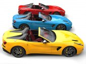 Photo Red, blue and yellow modern convertible sports cars - side view
