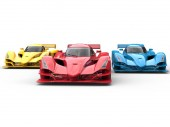 Photo Modern super sport race cars in red, blue and yellow