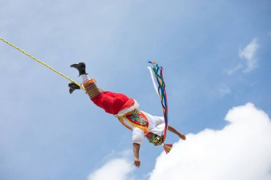 Voladores performing flying men show.