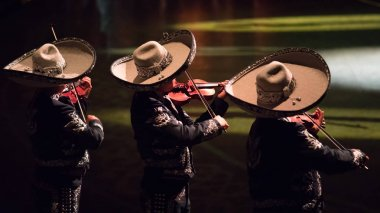 Mexican mariachis playing.