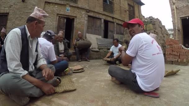 Nepalese men making music on a street.