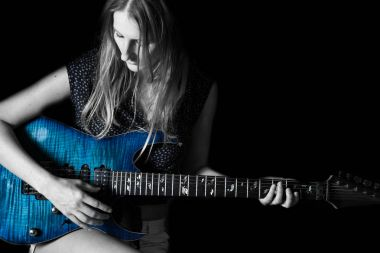 Young woman playing a guitar.