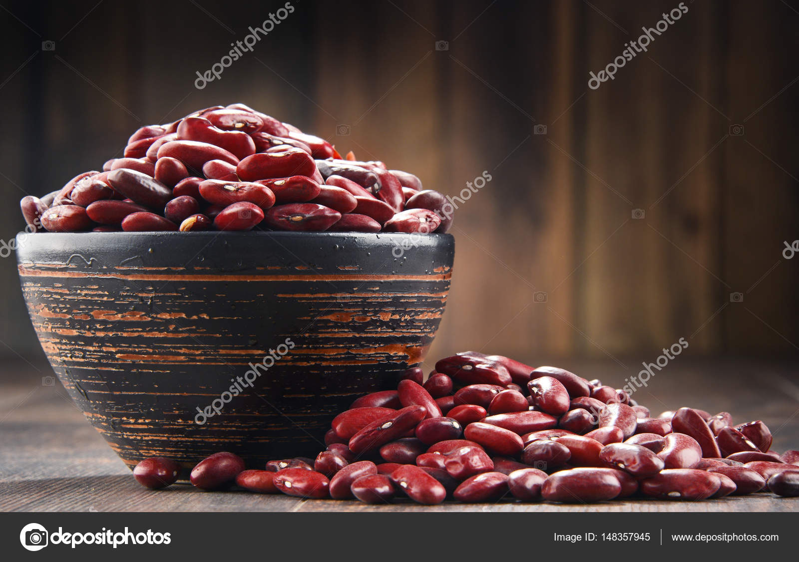 kidney bean table odd shaped composition with bowl of kidney bean on wooden table stock photo